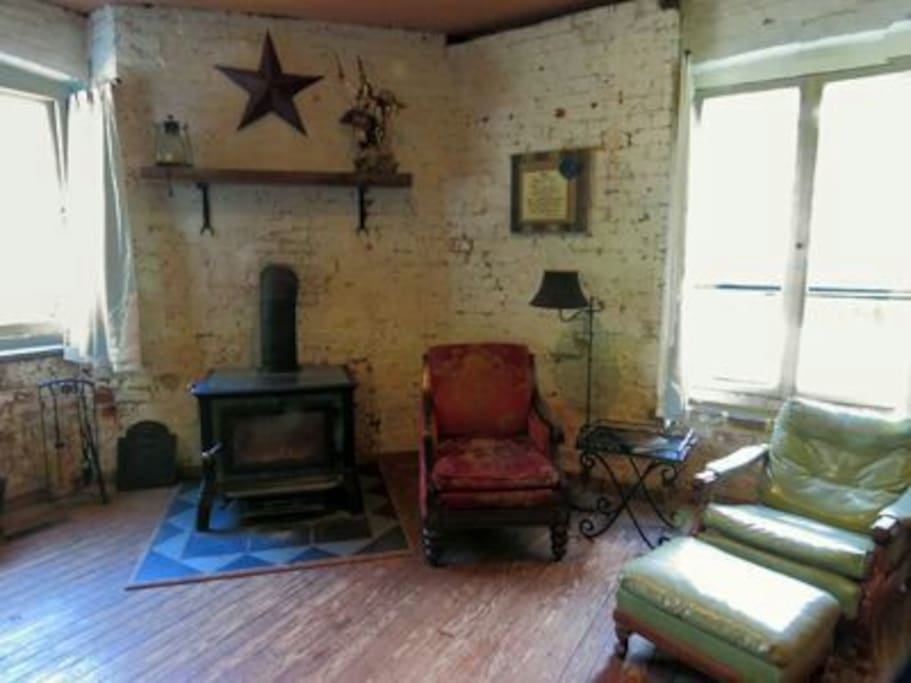Front sitting area by the woodstove and window to the field and creek.