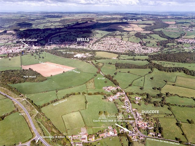 Aerial view of Dulcote and Wells Somerset showing Wells Cathedral which is about 1 mile from the Coach House B&B either across fields or on public footpaths
