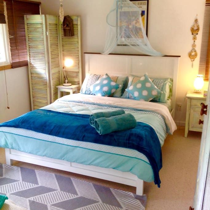 Queen size bed in bungalow. Towels and all bedding for your comfort and convenience.