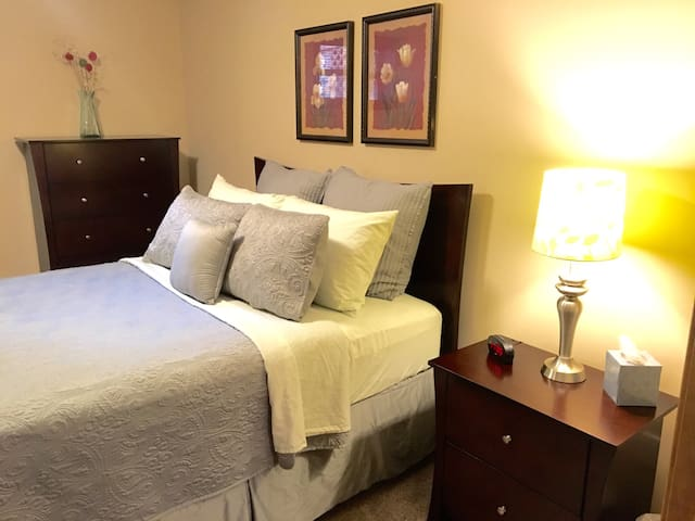 The cozy Queen size bedroom with a pillow top mattress.