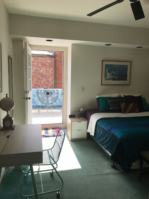 Balcony to bedroom with view overlooking downtown Montclair.