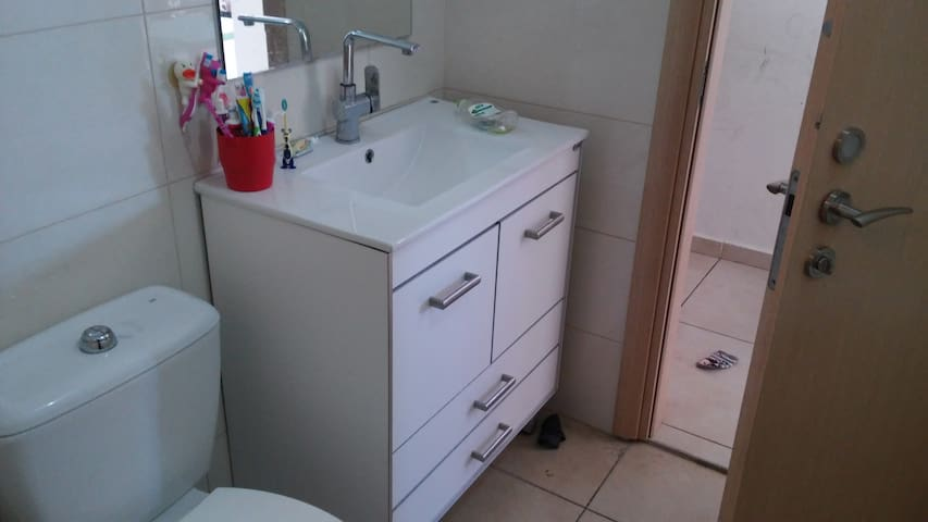 Toilet Centers has a bathtub, and a utility room includes a washer and dryer