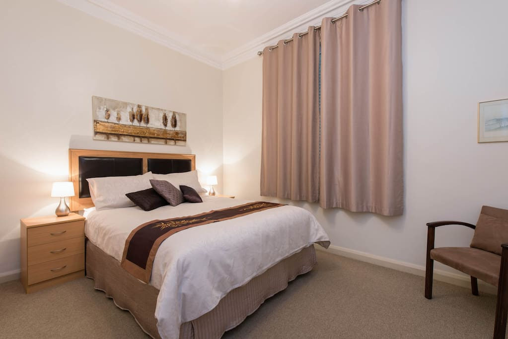 Large bedroom with Queen size bed and large wardrobe