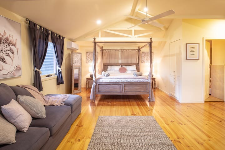 Your king master bedroom is a luxe 'parents' retreat' and includes a comfy sofa bed in case you need more flexible sleeping arrangements. Heated and cooled for your comfort, with reverse cycle aircon and ceiling fan
