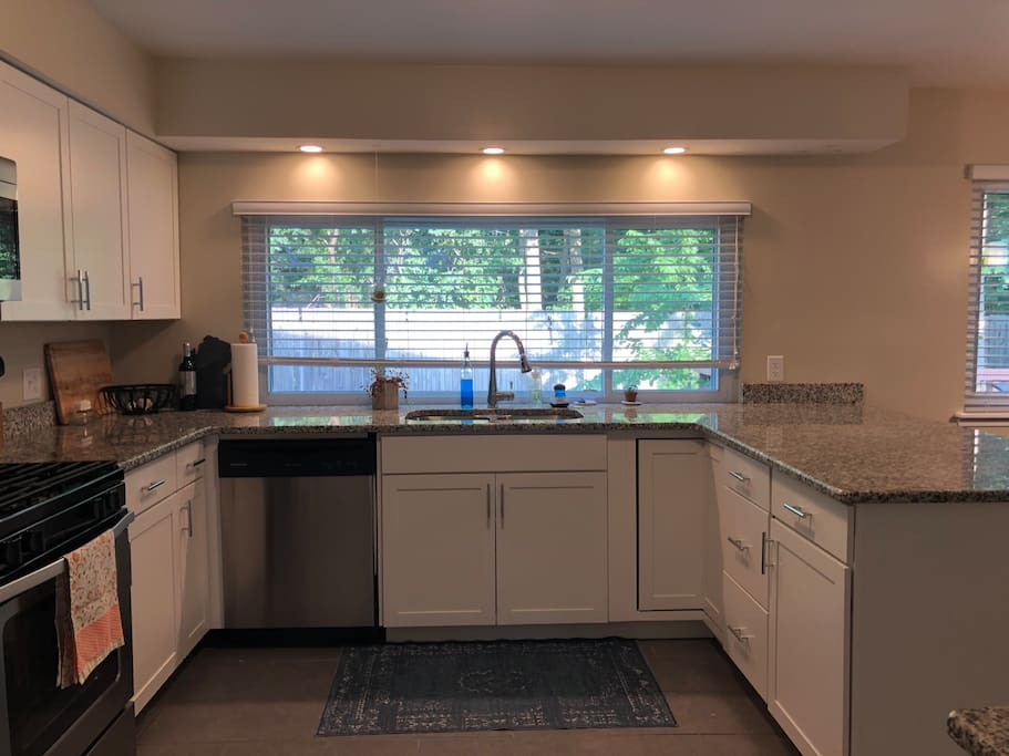 Open kitchen with eat in dining and second prep sink