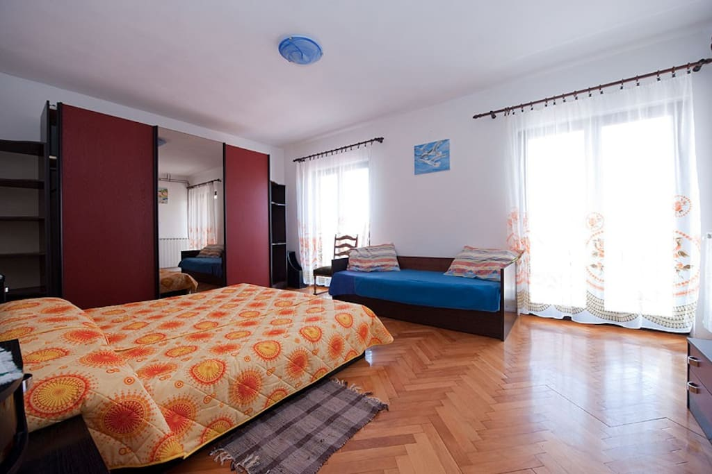 Master bedroom with a second bed for a child or a third friend