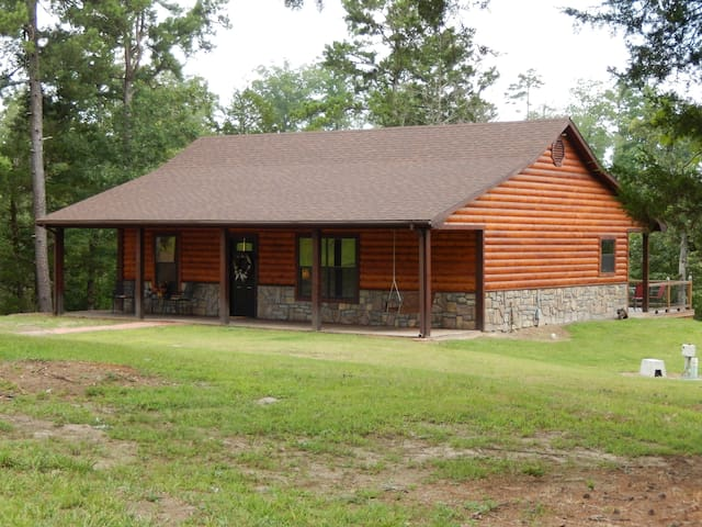 New Log style cabin on heavily wooded 2.8 acre lot.
