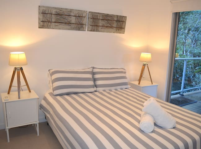 Second bedroom - Queen Bed. Downstairs and opens on to lower balcony with relaxing hammock.