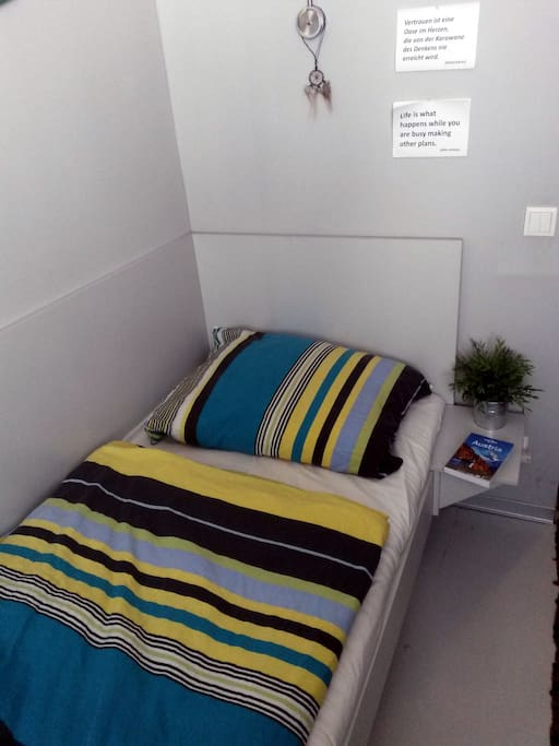 comfortable BED sleeping one person.