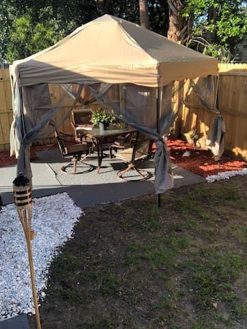 Enjoy the outdoors on the back Patio with a canopy to help shade the summer sun.
