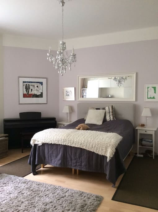 Separate bedroom with a king size bed