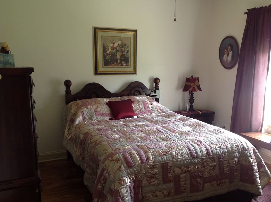 Queen pillow top with ceiling fan.