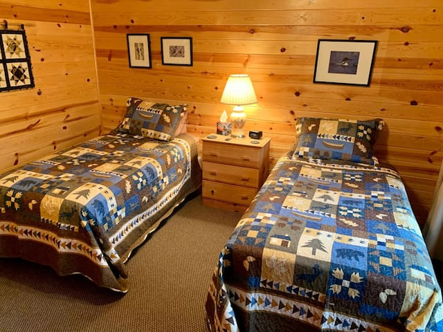Upper level bedroom includes two twin beds, 2 small dressers and plenty of storage in closet.  Pack n Play portable crib also available in closet.