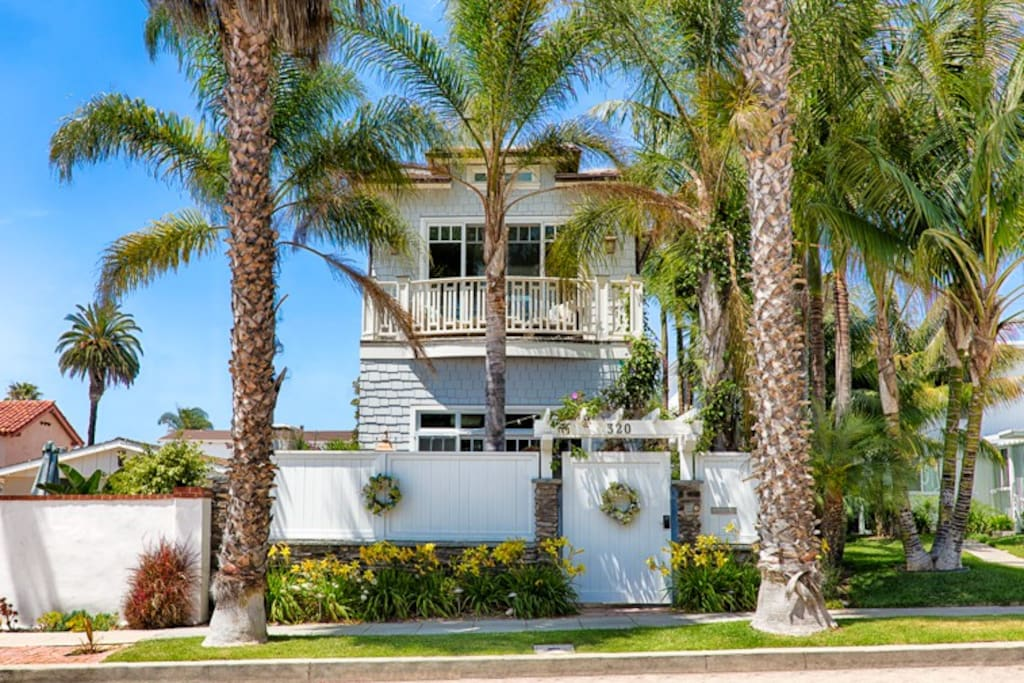 This private home nestled in the palm trees is just a short walk to the beach.