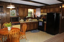 Eat in kitchen--fridge, stove, microwave, dishwasher, coffee maker. Includes plates, pots and pans, silverware and everything you need to prepare meals.