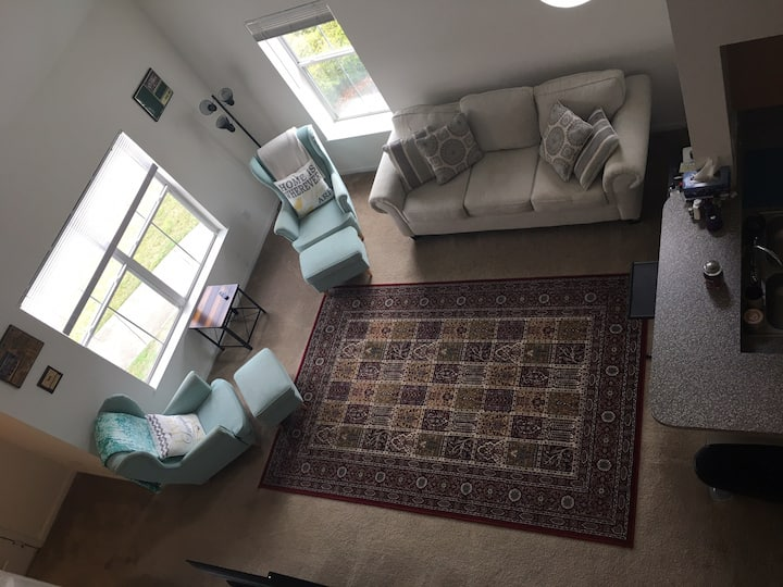 Two story loft style apartment with shared balcony