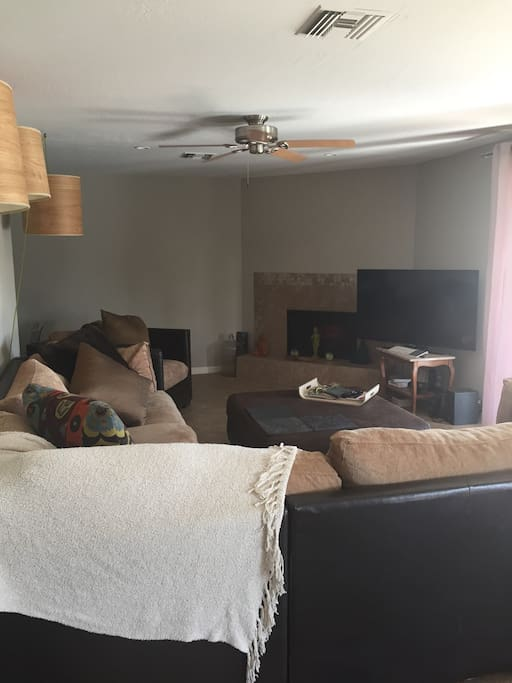 The couch is comfortable and cozy with a 55 inch smart tv. I have Netflix Hulu and a Mac mini attached to the television incase you need in house entertainment.