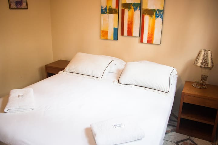 Room with one matrimonial bed and private bathroom