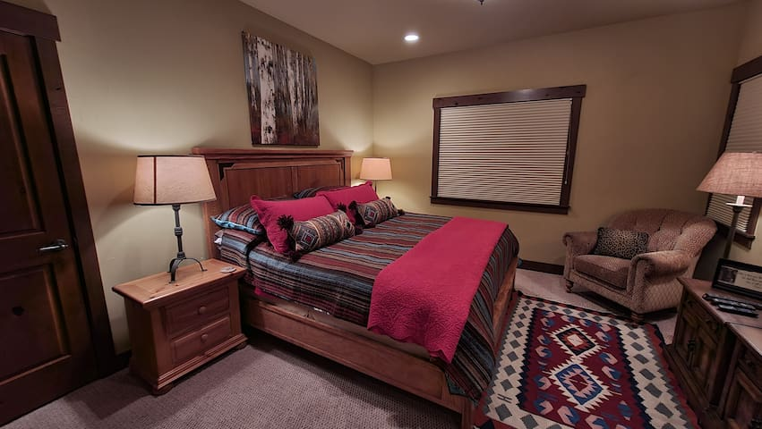 Bedroom #3, King size bed, sitting area, dressers,  HDTV, walk in closet