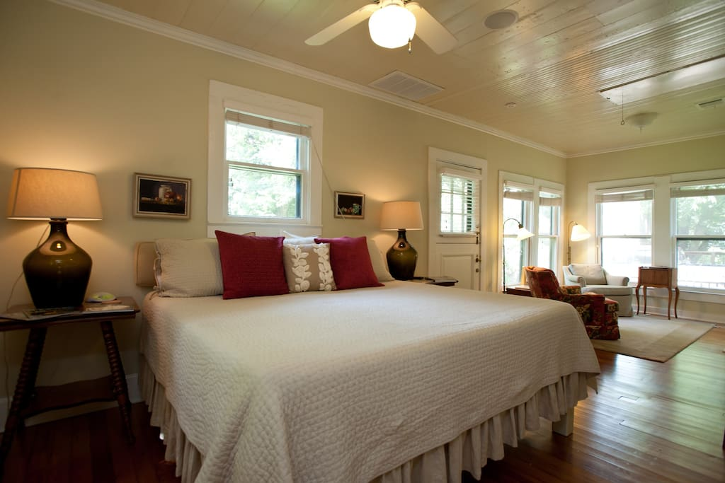 The bedroom is large and cozy and features hard wood floors and painted wood ceilings and an unbelievably comfy king-sized bed with organic mattress.