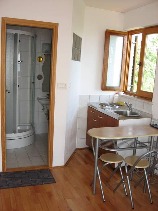 Bathroom and kitchen area.