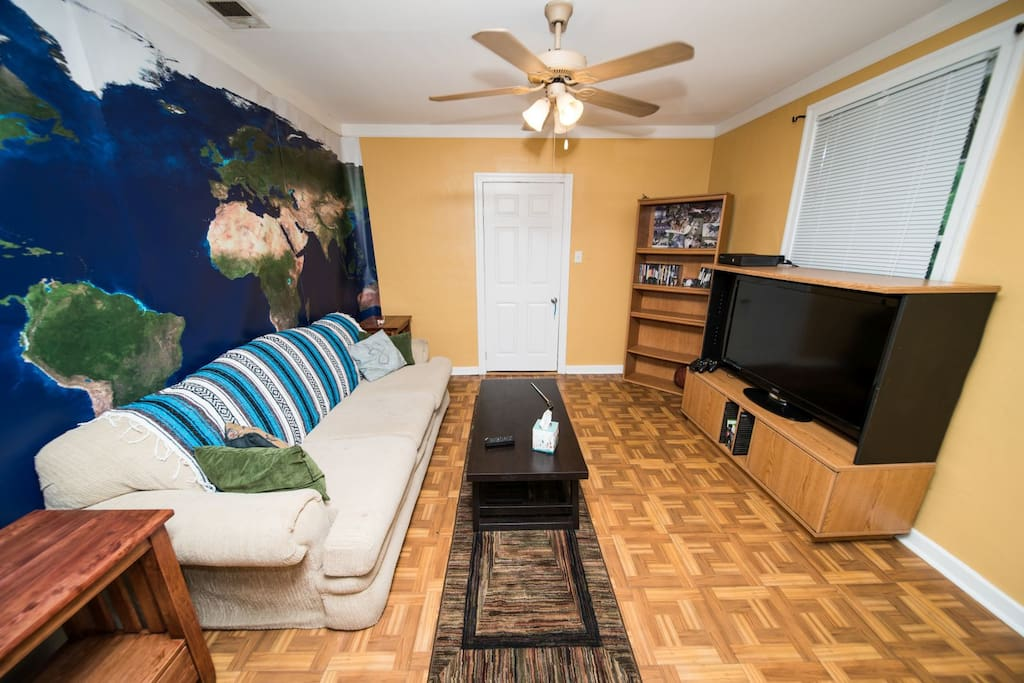 """Living room complete with 47"""" HD television, Chromecast & X-box. Comfy couch available for additional sleeping space (additional pillow and blanket available)."""
