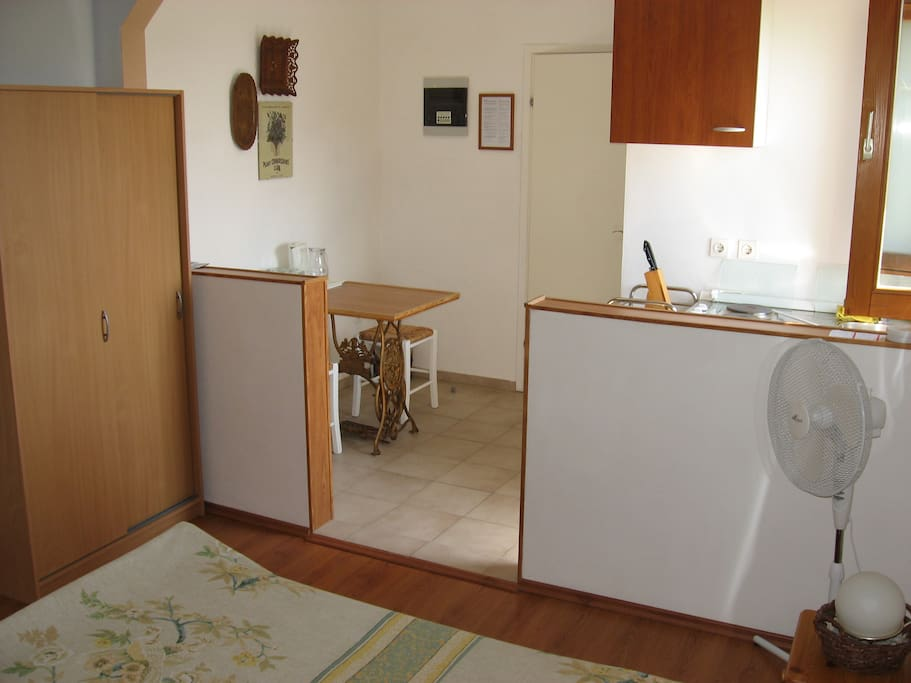 A view of the kitchen and eating area - Room 1.