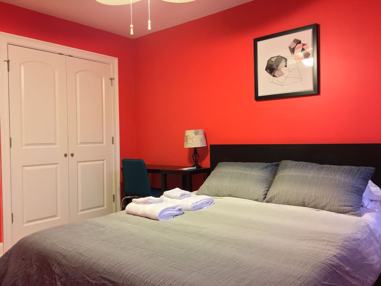 Queen bedroom also features a large double closet with iron and ironing board