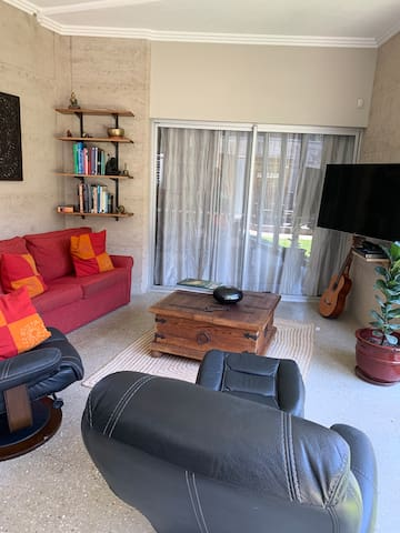 Lounge room equipped with TV plus DVD Coffee table houses many board games for your entertainment. We also leave instruments such as guitar for your enjoyment.