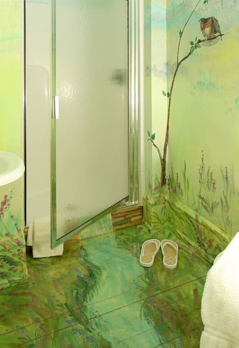 Bathroom with hand-painted mural.