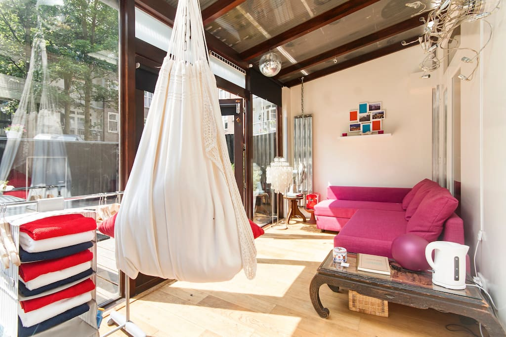 Private room for 4, with private steam shower and garden access. The sofa can be easily made into a comfortable double bed We provide our guest with fresh towels, sheets and duvets. Also toiletry like shampoo, handsoap, toothpaste, moist towels are available