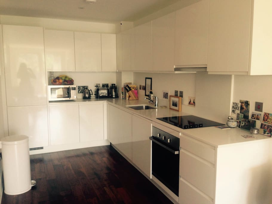 Fully equipped, modern, high spec kitchen.  White Quartz sideboards