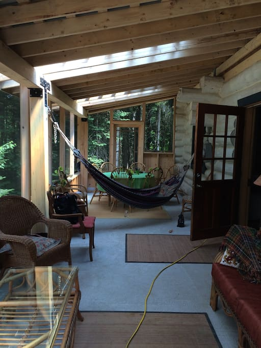 Enjoy the new screened in porch- perfect for dining outside, reading, or napping in the hammock.