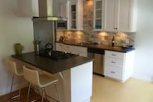Newly-remodeled kitchen with all new appliances, fully furnished.