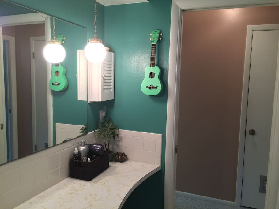 Full bathroom features tub, essentials such as shampoo, etc and a working ukelele for your playing enjoyment.