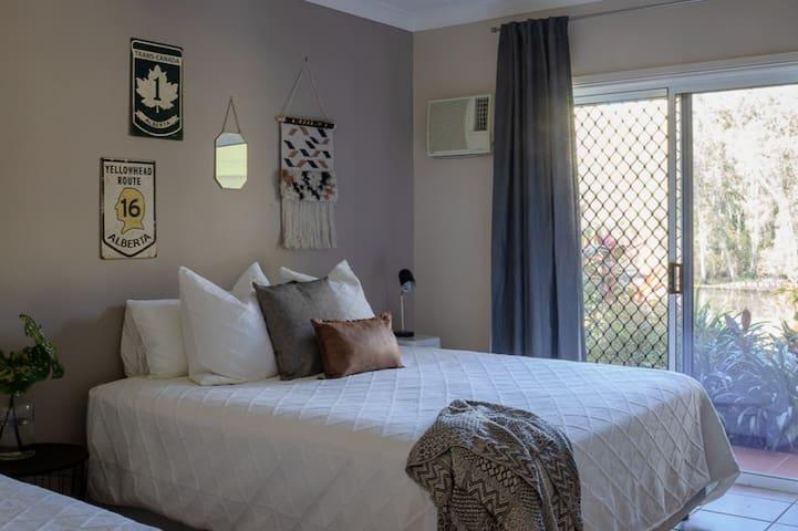 King bed with billabong views