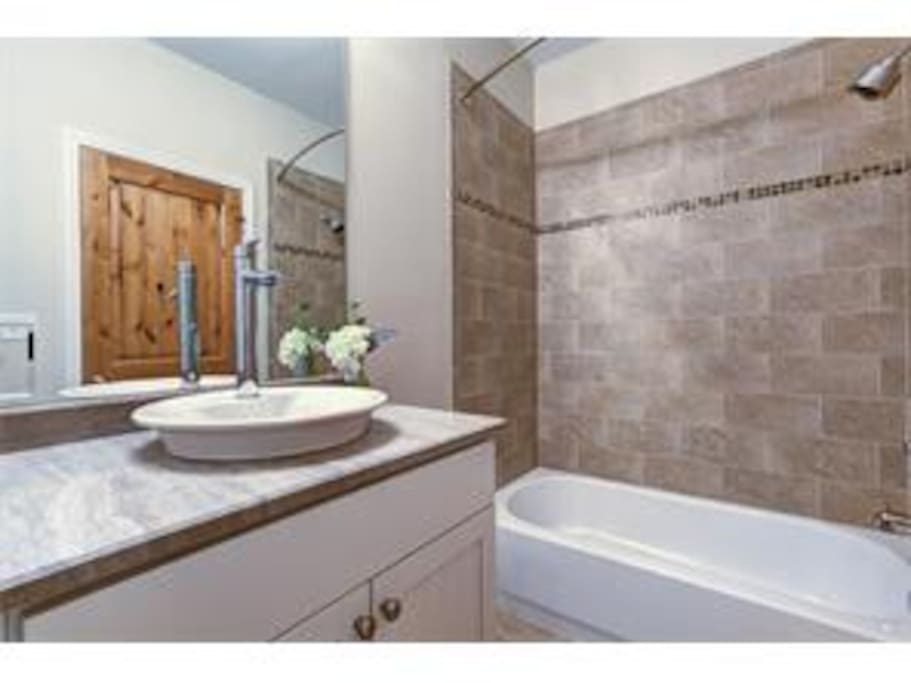 Bathroom with natural stone and tile