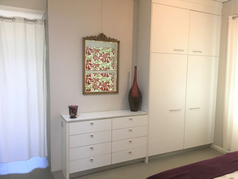 Drawers and a Large Wardrobe Provide More than Enough Storage for Guests