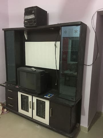 Show case with TV and Music System