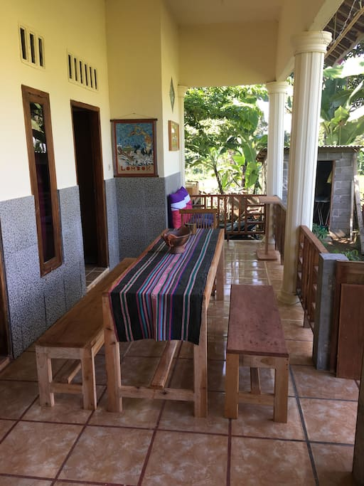 Terrace with dining table and relax corner