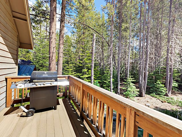 Enjoy the crisp mountain air on the deck overlooking the forested property.