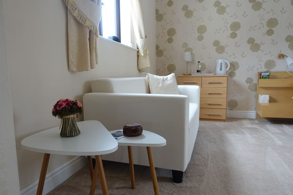 Two seater sofa and side coffee tables