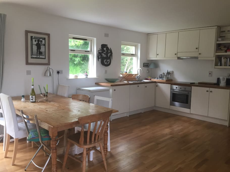 large open plan kitchen, with lovely fireplace.. ideal for relaxing while food is being prepared.