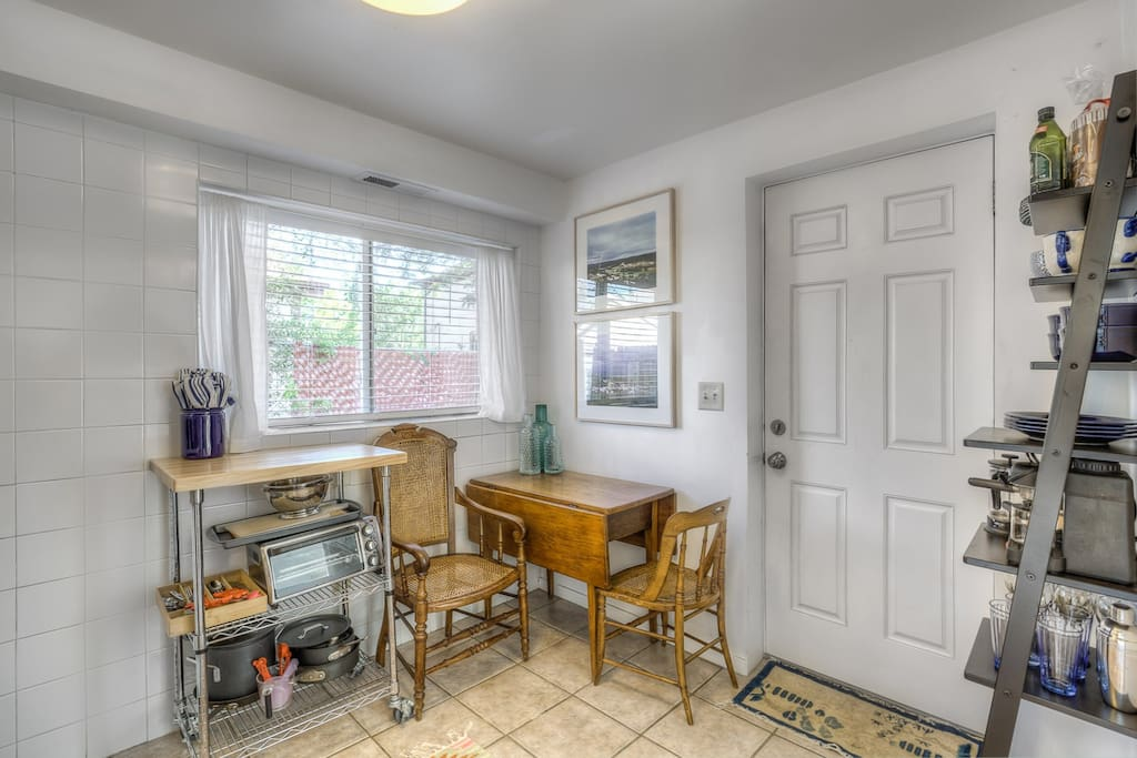 Eating area in kitchen and entrance.