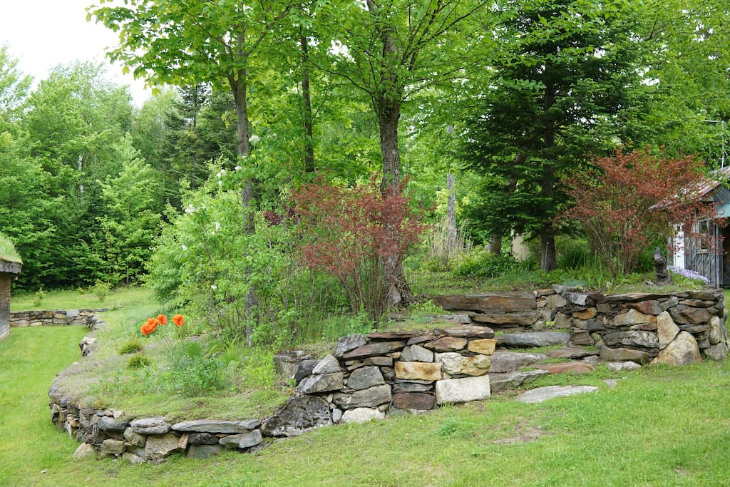 Charming perennial gardens accented with natural stone