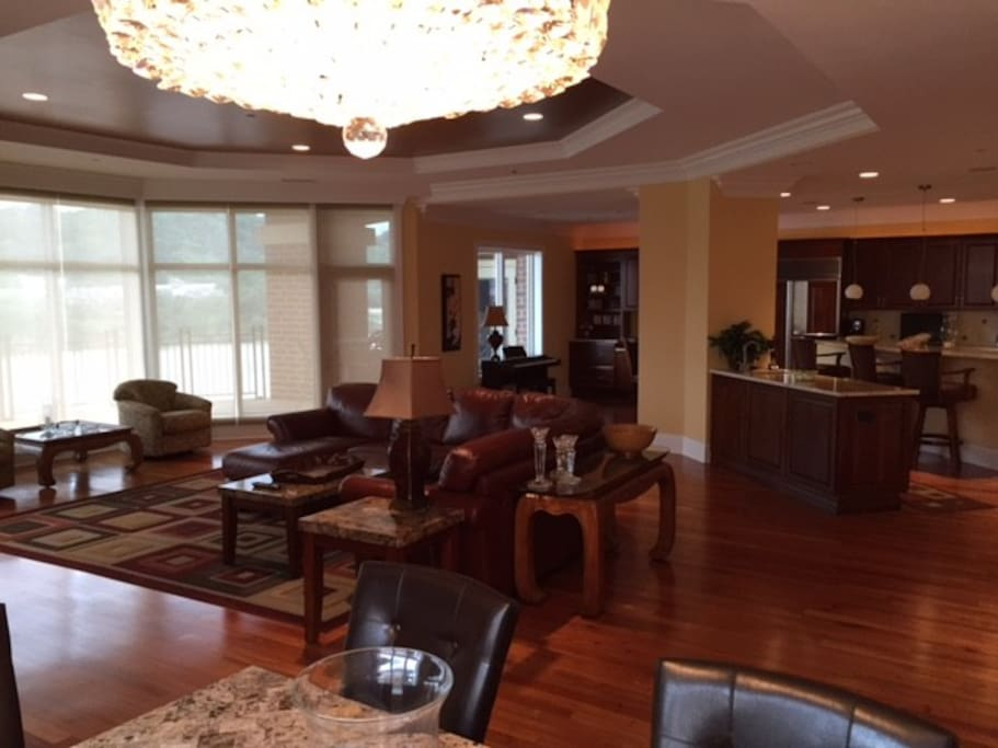 large great room with living room, dining room, and kitchen all facing terrace and Ohio River view