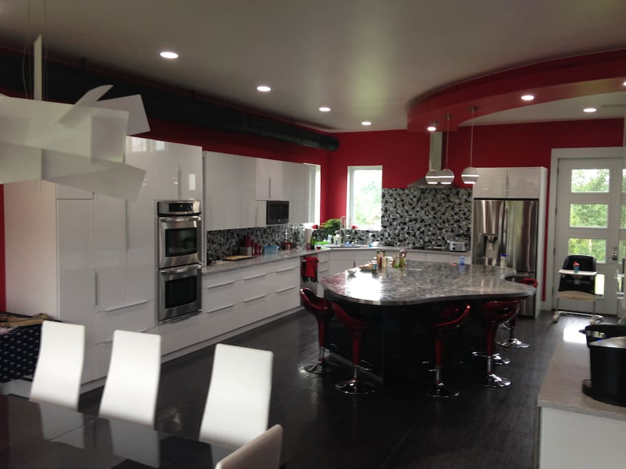 huge kitchen with stainless appliances and island.  Sleek modern and spacious.