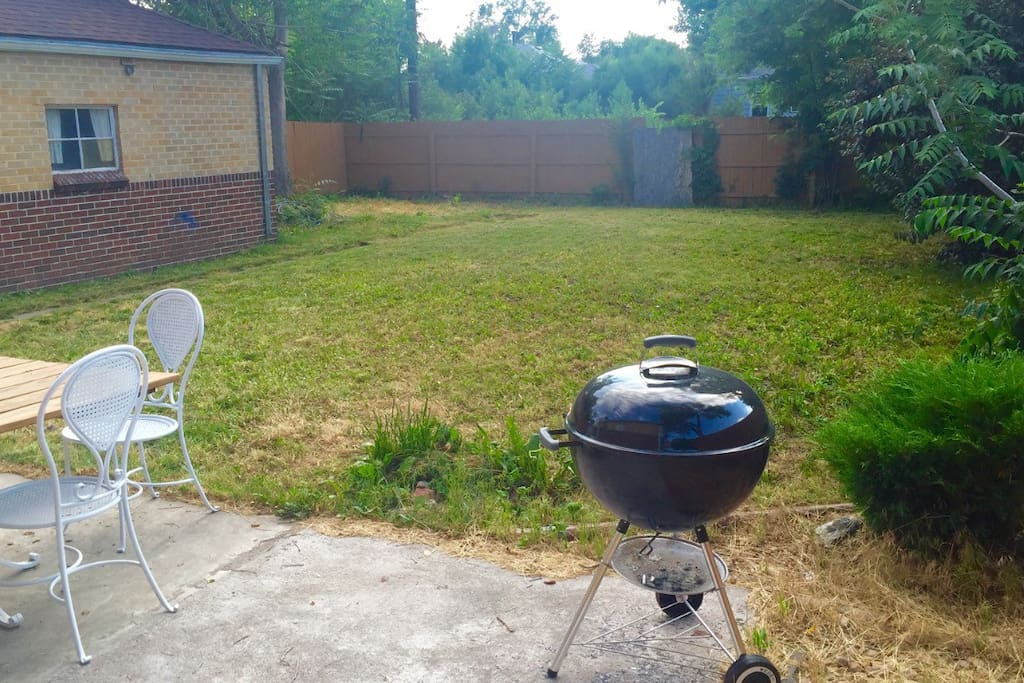 There is a private yard with patio furniture, a charcoal bbq, and a 6 foot privacy fence!