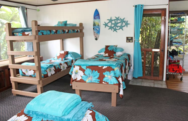 Fun backroom with 4 twin beds is perfect for kids and adults!
