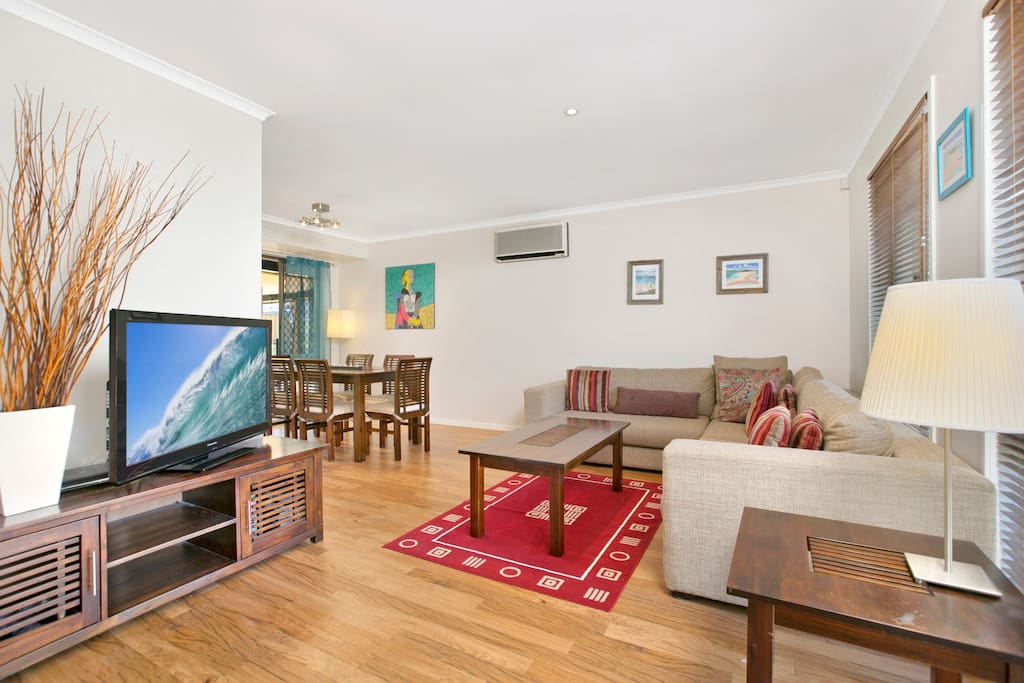 Main Living Room with large flatscreen TV and Blue Ray DVD multi region player. Dining room adjacent